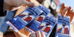 Fans Show Tickets for Super Bowl Game